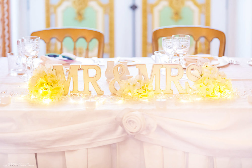 Mr and Mrs signs on the head wedding table