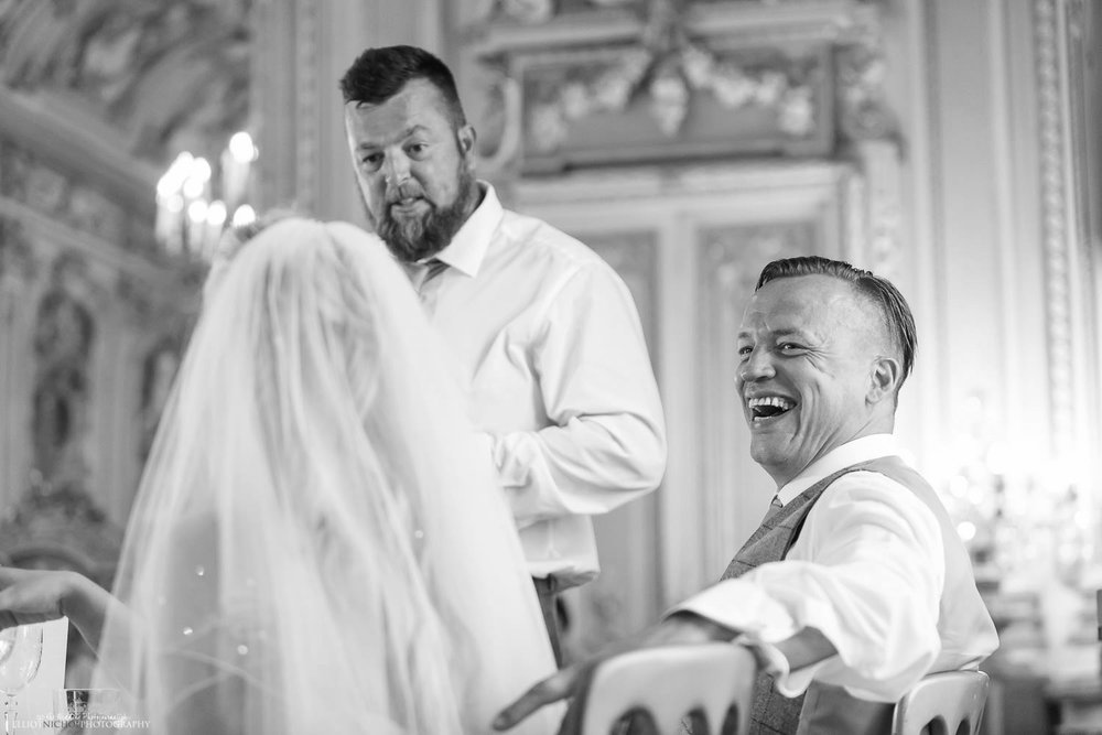 groom laughing during the wedding speeches