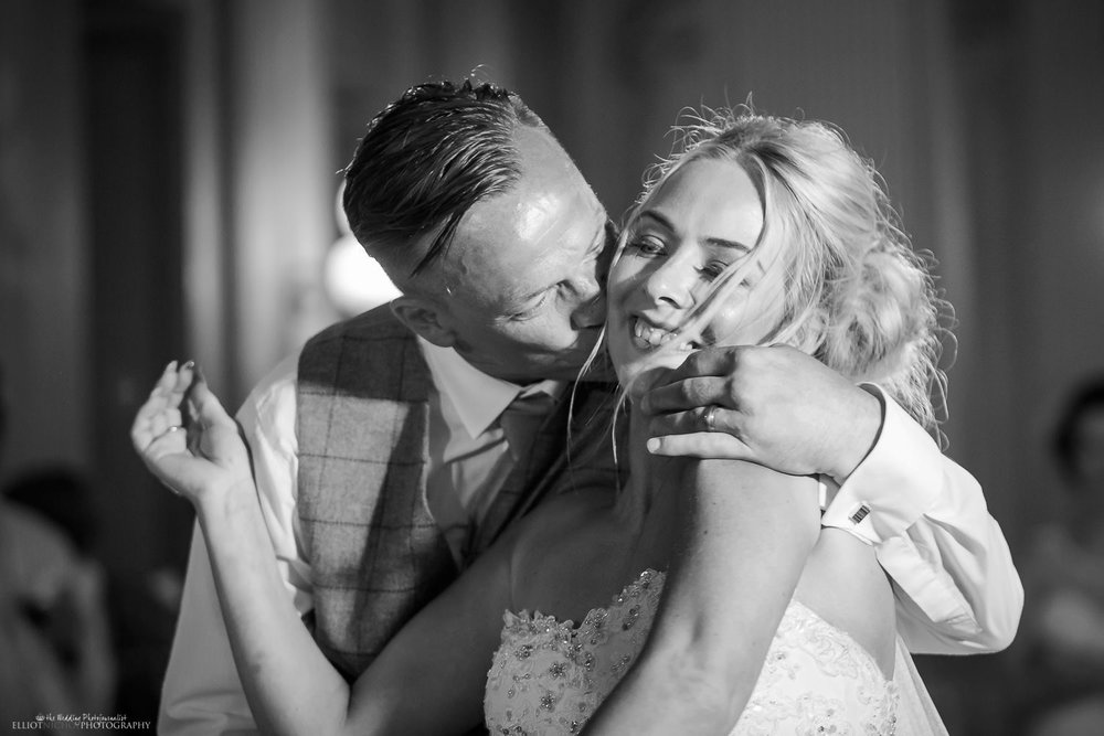 Groom kisses his bride during the first dance