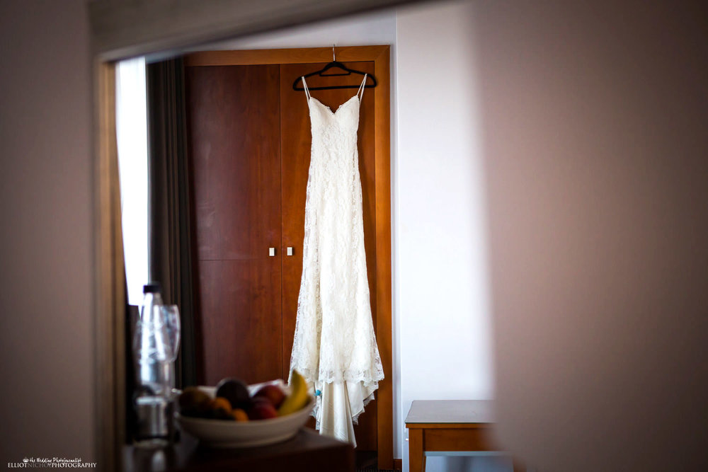 wedding dress hanging in the hotel room at the Radisson Blu, St Julians, Malta