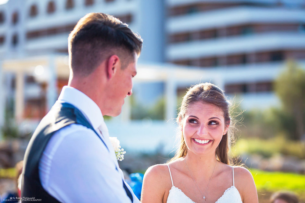 Bride and Groom during wedding ceremony at The Edge, Radisson Blu, St Georges Bay, St Julians, Malta.