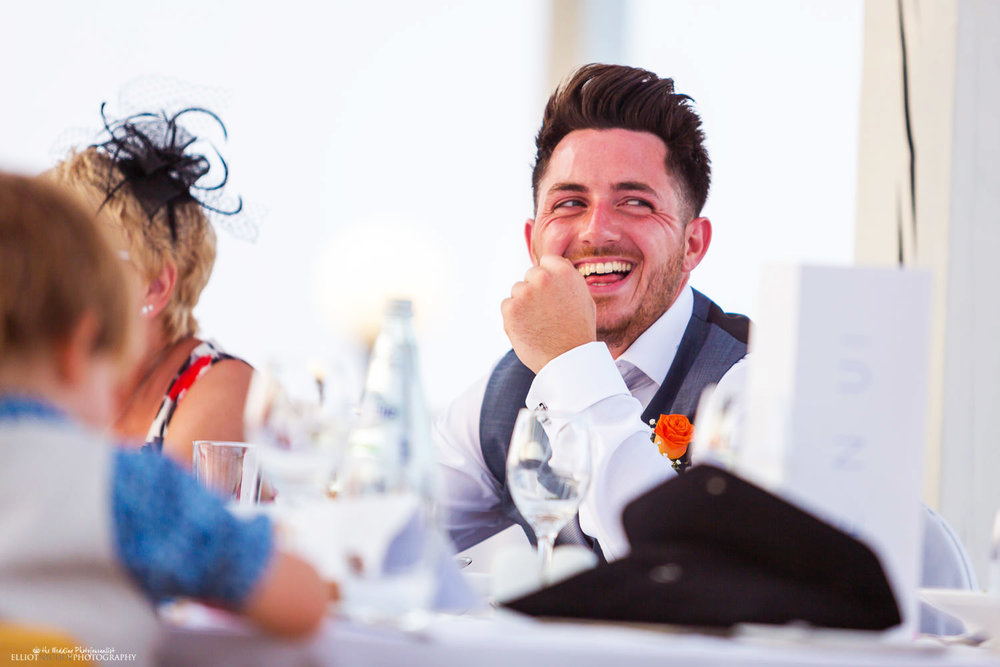 Bestman laughing during the wedding reception in Malta.