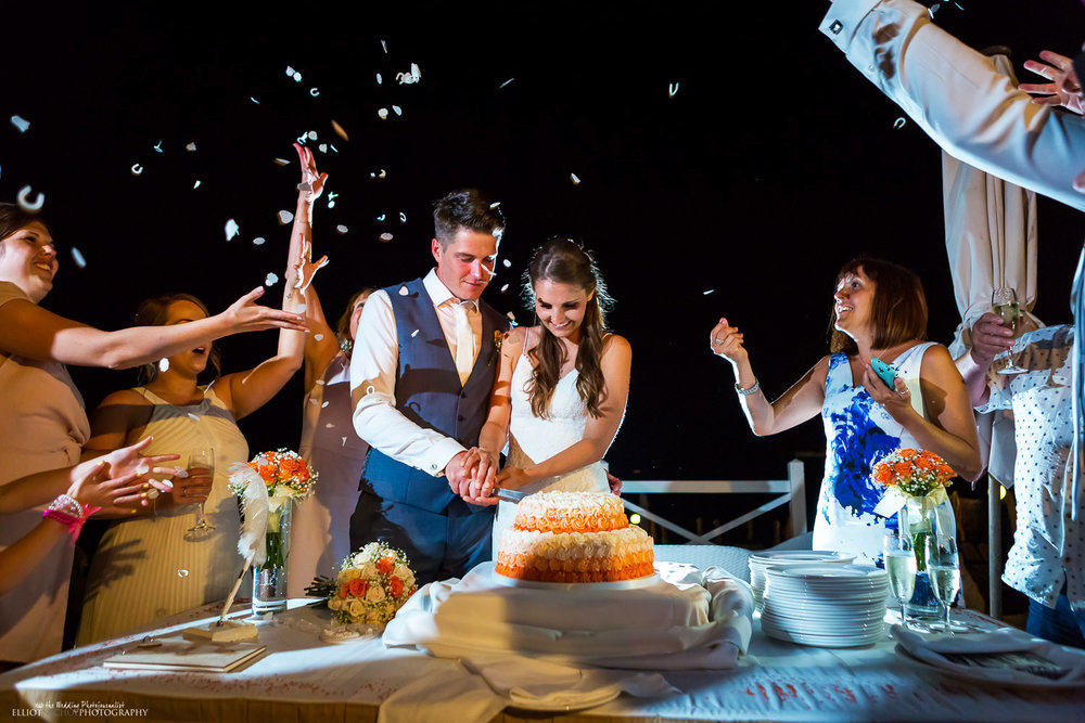 bride and groom cut their wedding cake at the Edge in the Radisson Blu Resort, Malta.
