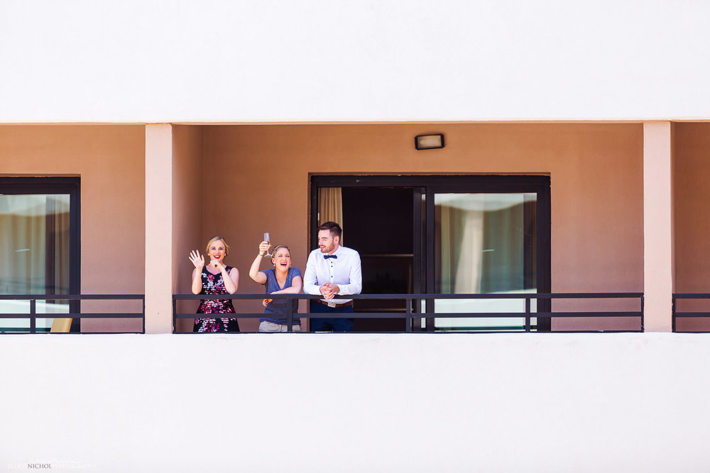 wedding guests having a drink on their hotel balcony at the Radisson Blu Resort, Malta.