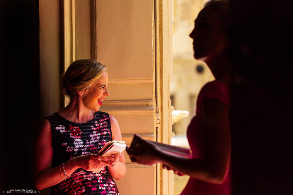 Wedding guest handing out ceremony information at church door