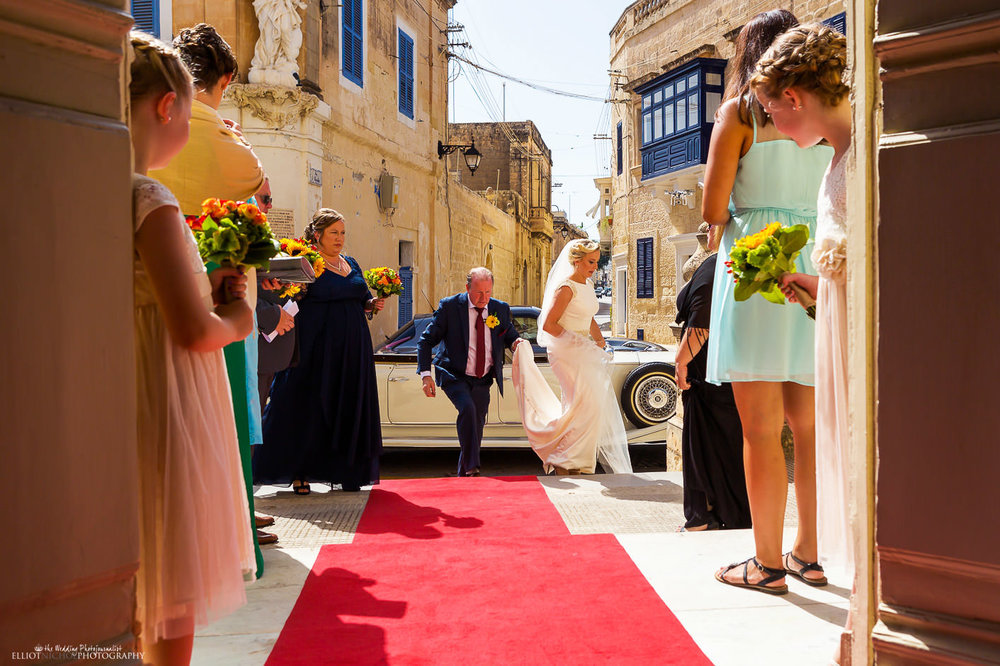 Bride and her father arrive at the church ceremony in Malta