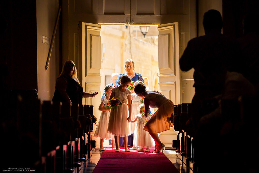 Bridal party gets ready to make their processional into church in Attard, Malta.