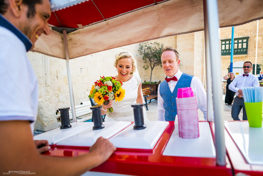 Bride and Groom have ice cream after their church wedding ceremony in Attard, Malta