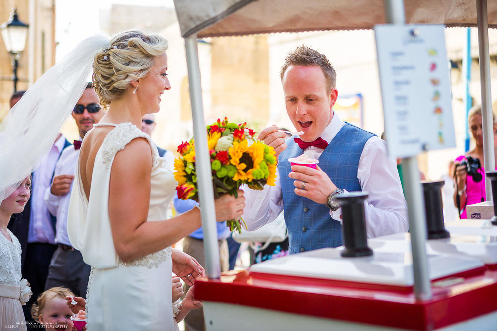 Groom tastes some Sicilian ice cream after his wedding ceremony.