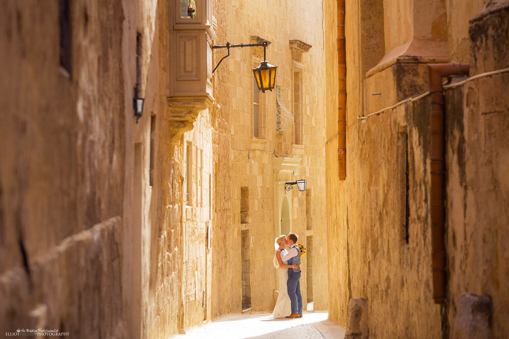 Bride & Groom kissing in the streets of Mdina, Malta