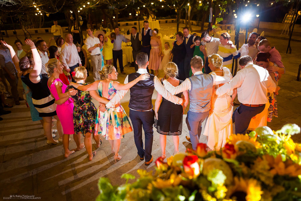 wedding guests dancing with bride and Groom at wedding venue in Malta. Photographer Elliot Nichol