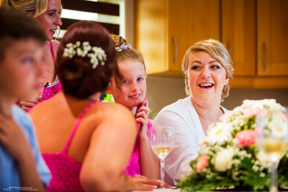 Bride relaxing with her wedding party