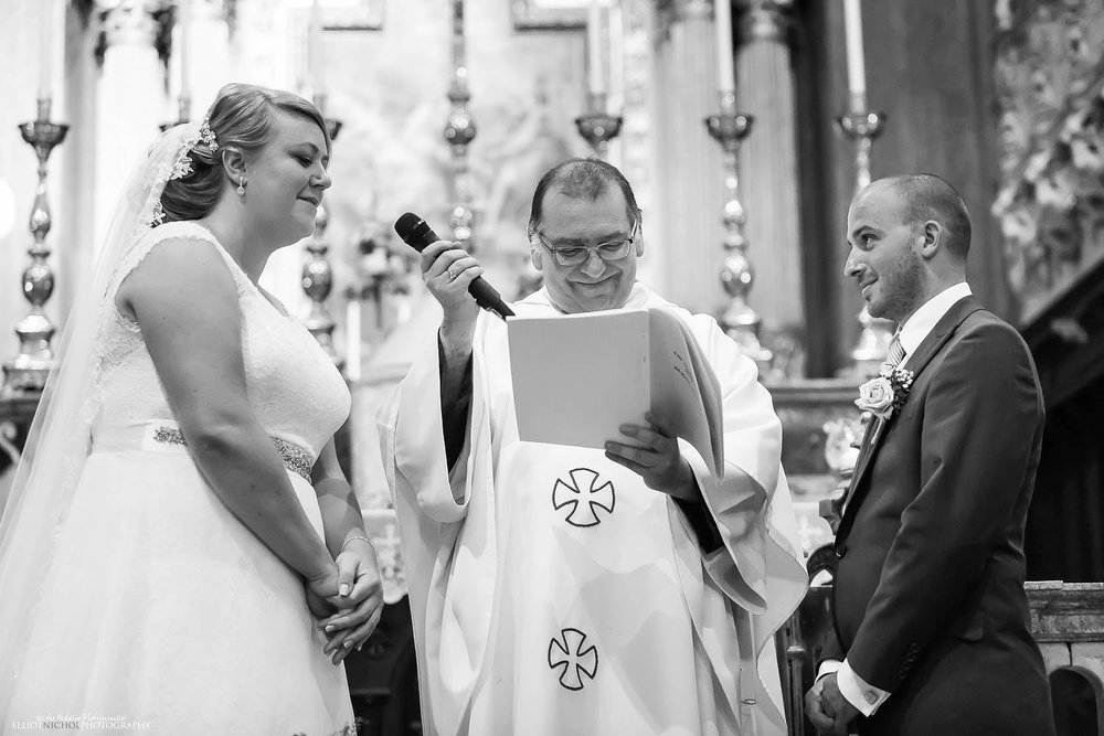 Bride and groom say their vows during the church wedding ceremony in Malta