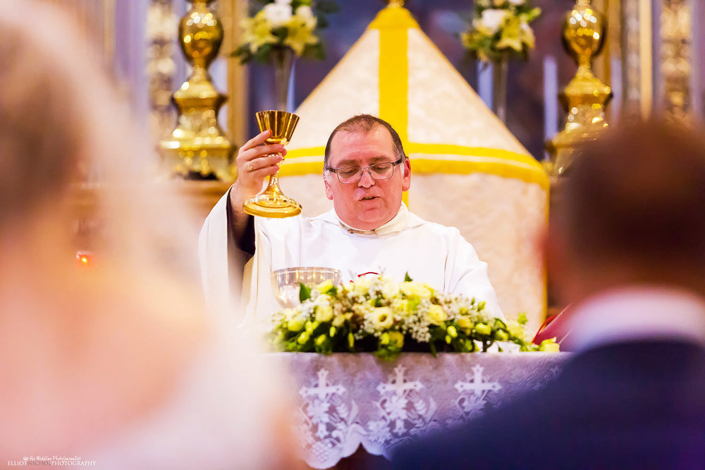 priest during the church wedding ceremony in Malta