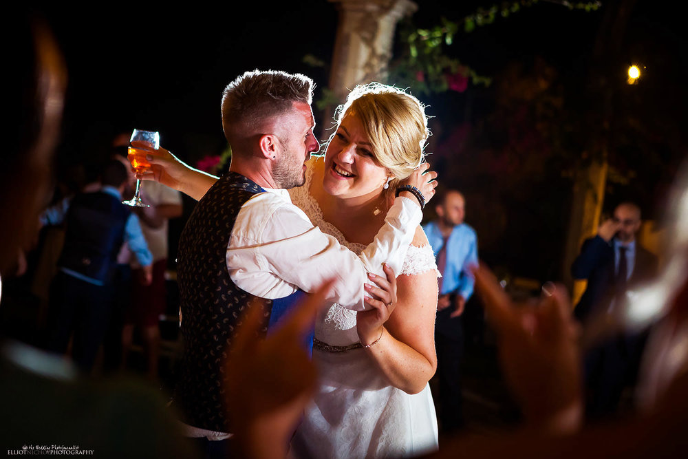 Bride gets hugged on the Dance floor by her wedding guest
