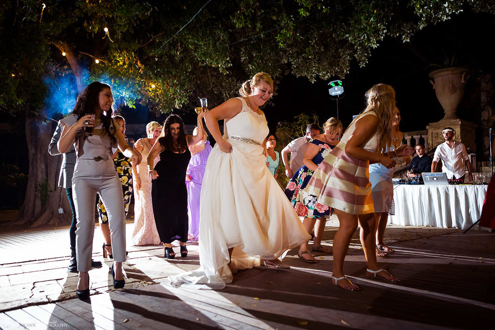Bride on the dance floor with her wedding guests at Villa Bologna
