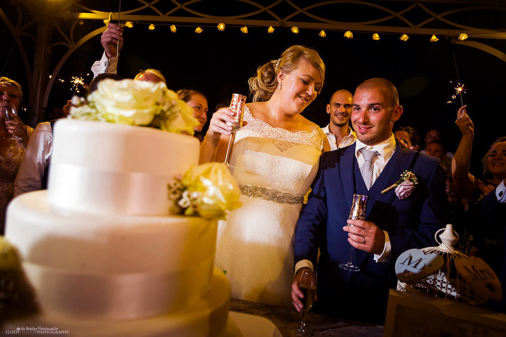Bride and Groom with champagne after cake cutting