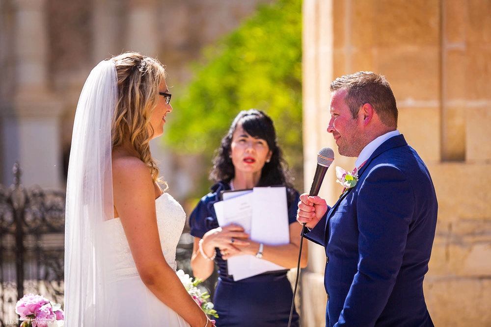 Groom says his vows during the garden wedding ceremony at Villa Bologna, malta.