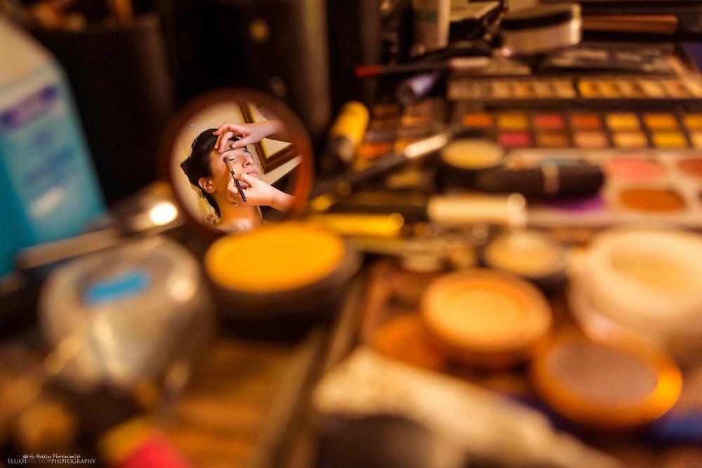 Bride reflected in makeup mirror in Malta.