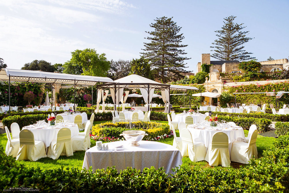 Garden wedding reception setup at Palazzo Parisio in Malta.