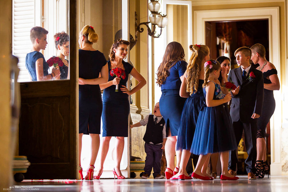 Bridesmaid and guests arrive at the Palazzo Parisio for the wedding ceremony in Malta.