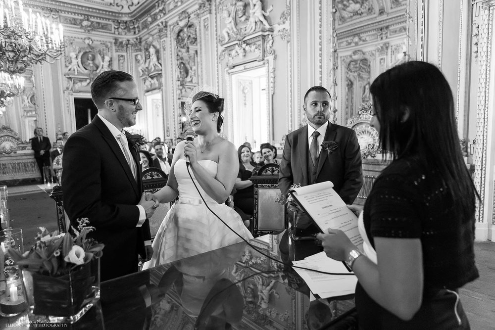 Bride and groom say their vows during the wedding ceremony in the Ballroom of the Palazzo Parisio in Malta.