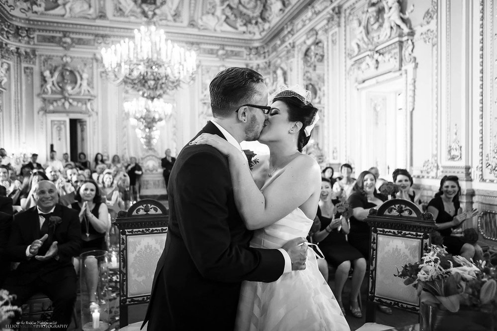 Husband and wife kiss for the frist time after their wedding ceremony