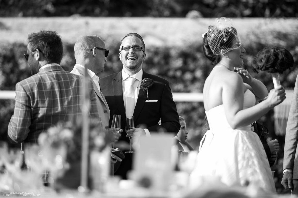 Groom laughing with his guests in the garden of the Palazzo Parisio in Malta.
