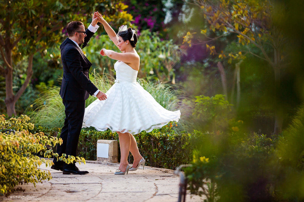 Bride and groom dancing in the gardens of the Palazzo Parisio. Malta wedding Photographer.