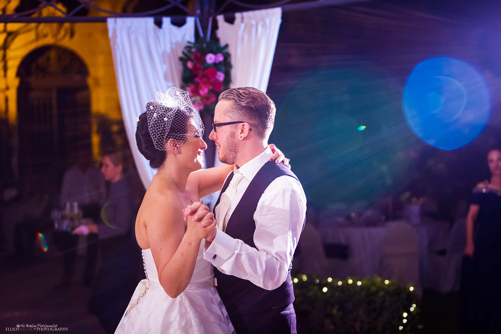 Bride and Groom take their first dance together in the gardens of the Palazzo Parisio, Malta