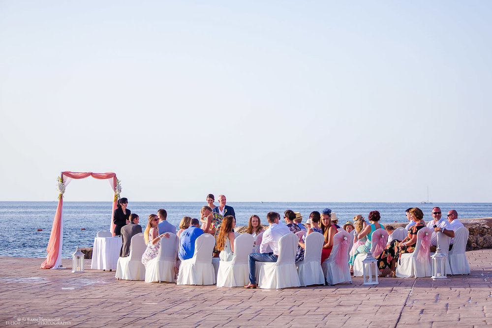 Groom and guests wait at the wedding ceremony at the Dolmen Hotel in Malta.