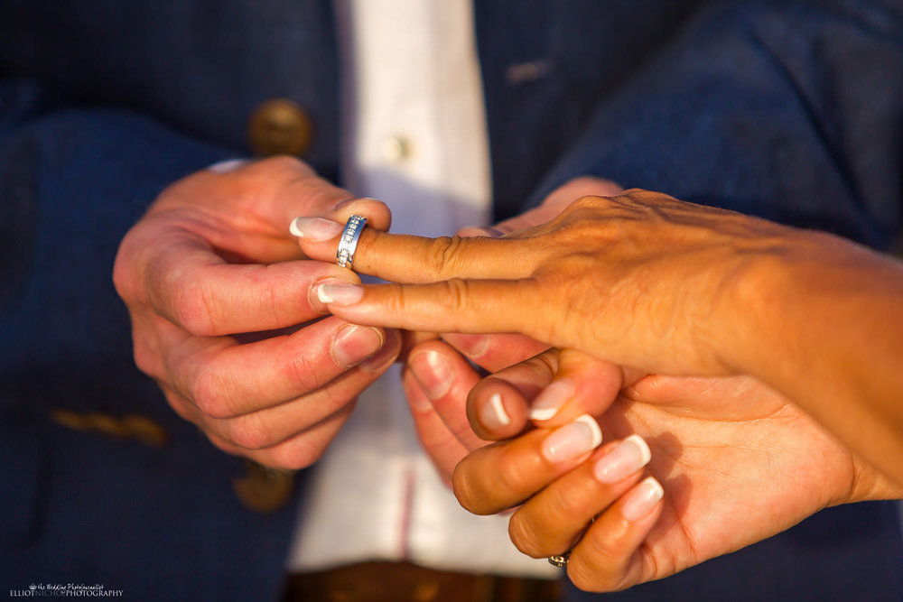 Groom puts on the wedding ring onto his Brides finger diuring the wqedding ceremony