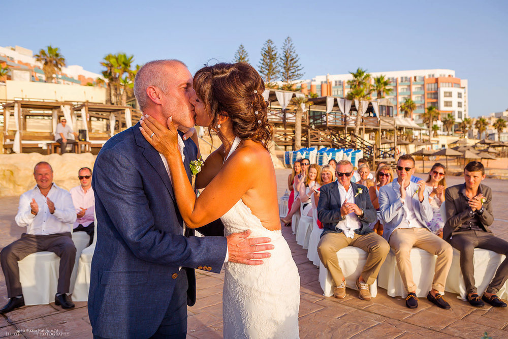 Husband and wife kiss for the first time at the Dolmen Hotel in Malta