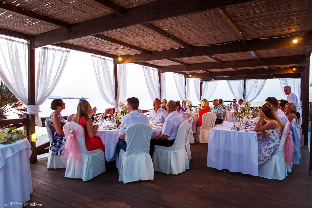 Wedding guests sitting down in the Aqua Terrace for the wedding reception at the Dolmen.