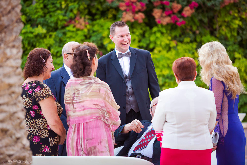 Groom greeting his wedding guests in the Garden at Villa Mdina, Naxxar, Malta