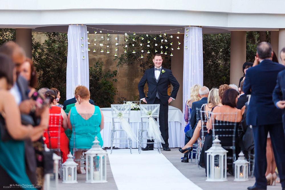 Groom waits at the wedding ceremony for his bride at Villa Mdina, Malta.