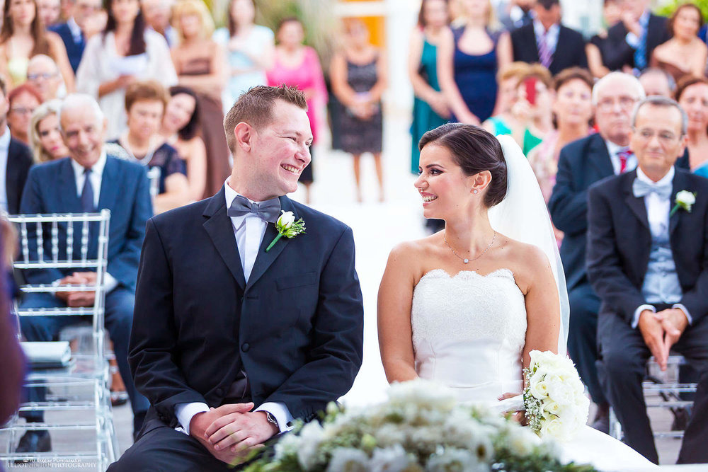 Bride and Groom smile at each other during the wedding ceremony