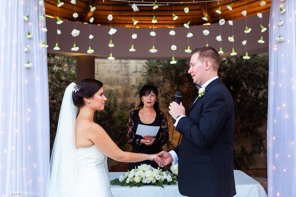 Groom says his vows to his bride at Villa Mdina, Malta