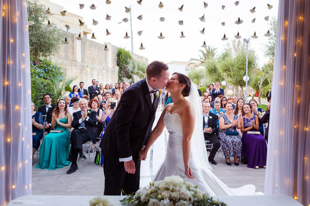 Husband and wife kiss for the first time at Villa Mdina, Naxxar, Malta photography.
