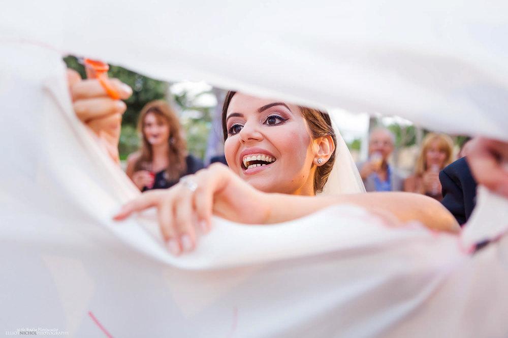 Bride cuts her way through the wedding sheet