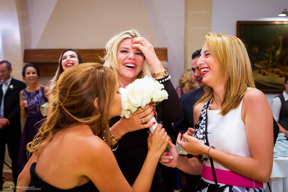 Single woman caught the bridal bouquet toss