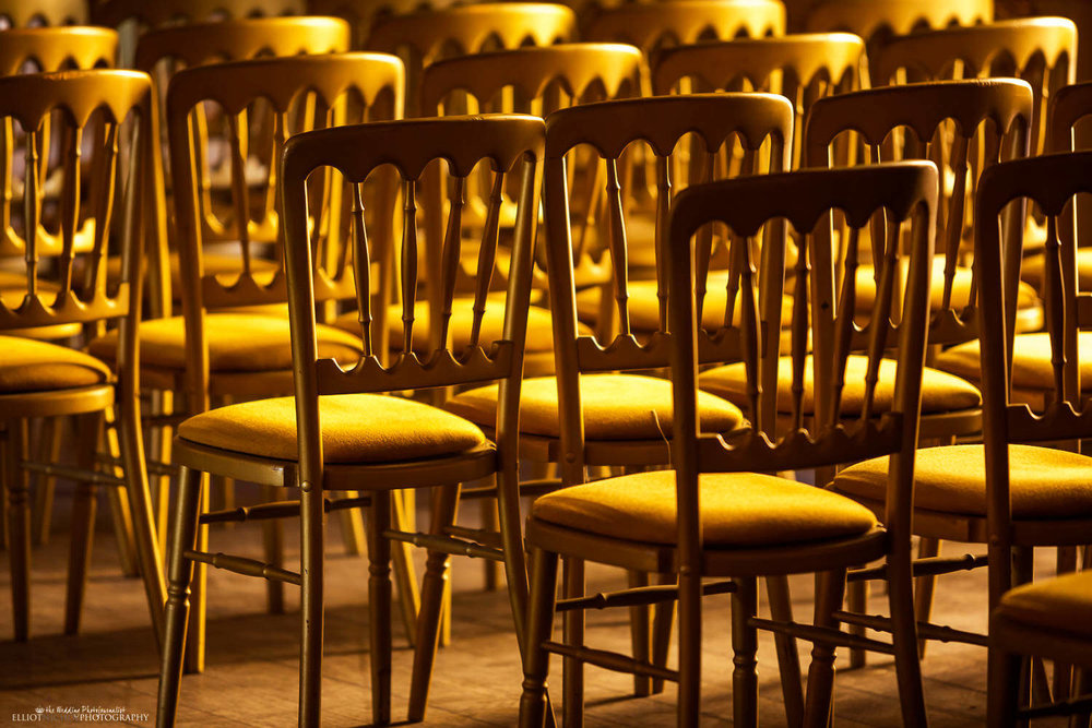 Golden chairs at the wedding ceremony setup in the Ballroom of the Palazzo Parisio, Malta.