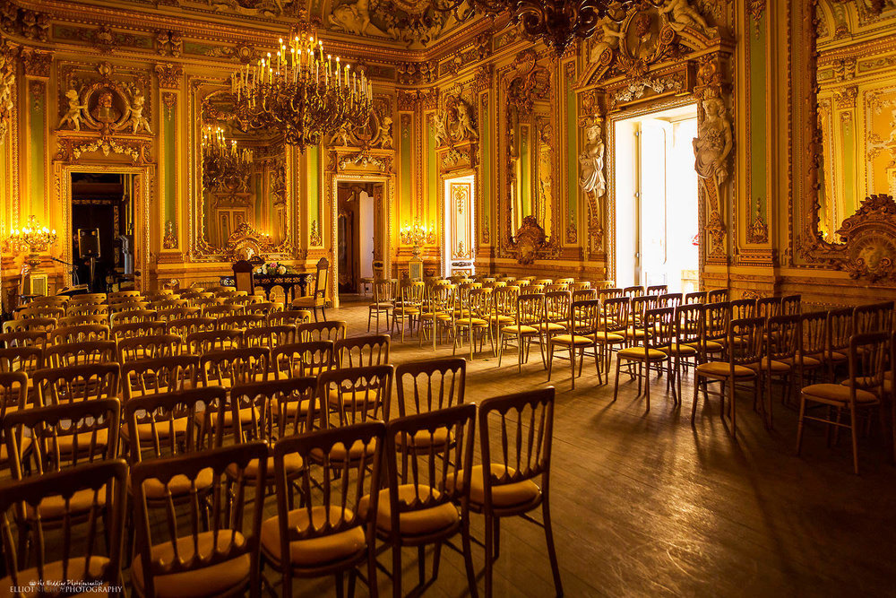 Palazzo Parisio's wedding ceremony setup in the golden Ballroom in Malta. Photography by Elliot Nichol
