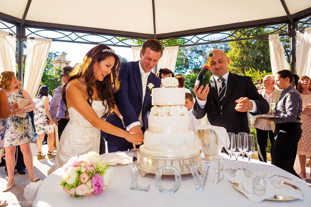 Bride and Groom cut their wedding cake in the Gardens of the Palazzo Parisio, Malta.