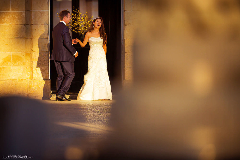 Bride and groom having fun at Palazzo Parisio, Malta.