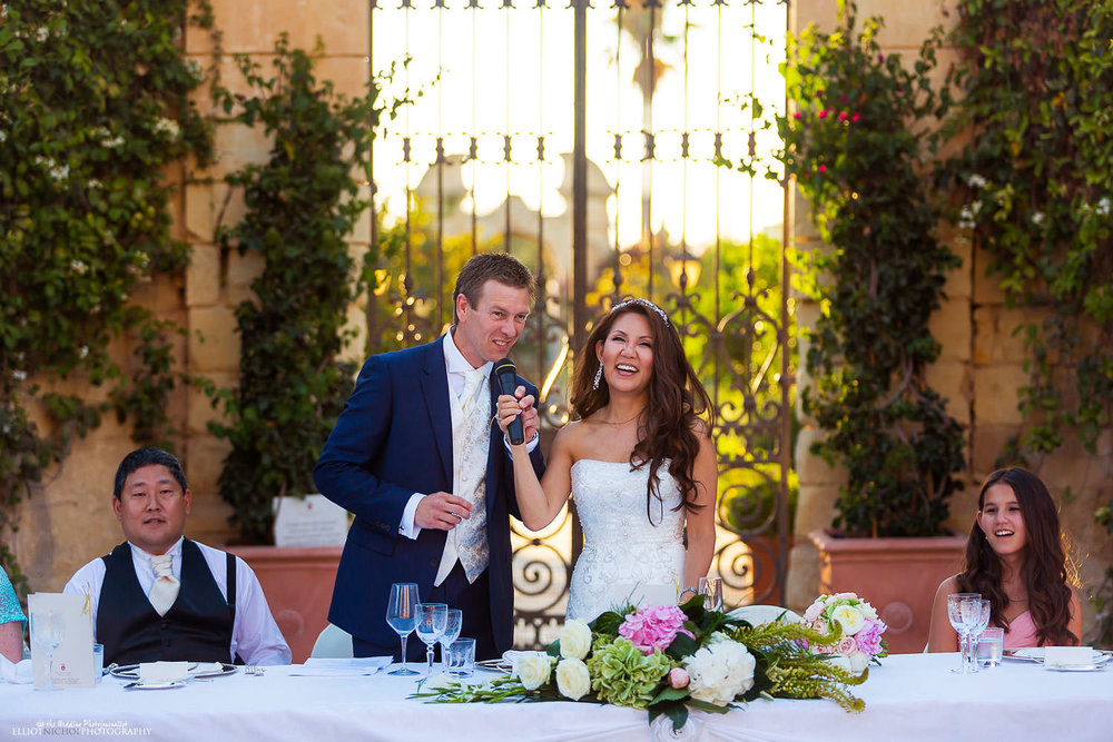 Bride and Groom make their wedding speech together in the gardens of the Palazzo Parisio, Malta.