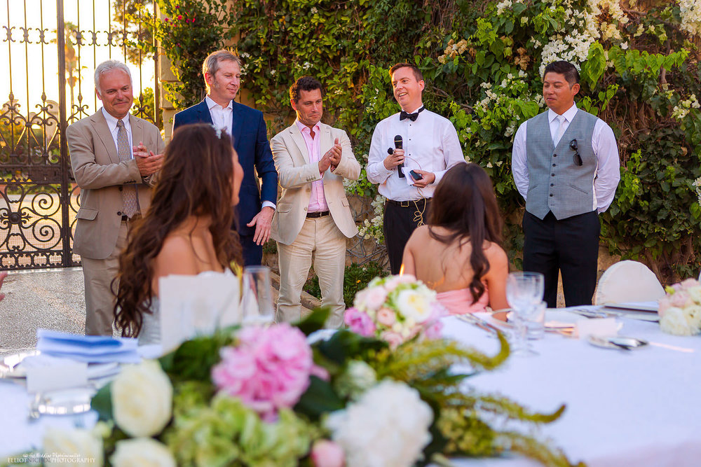wedding guests make a collective speech together about the happy couple.