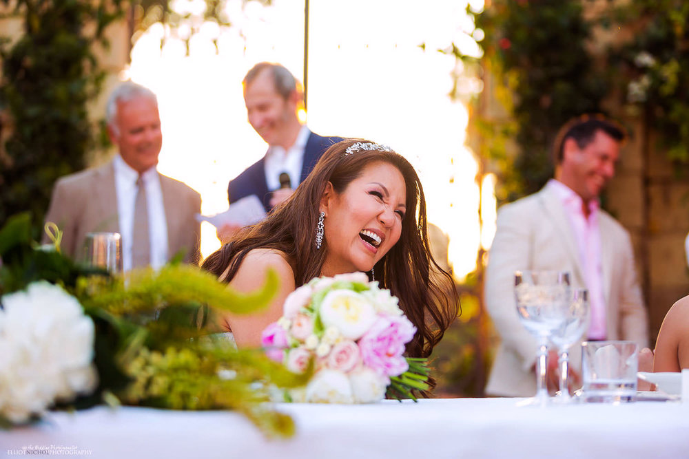 Brides reaction to the speeches at her wedding reception.