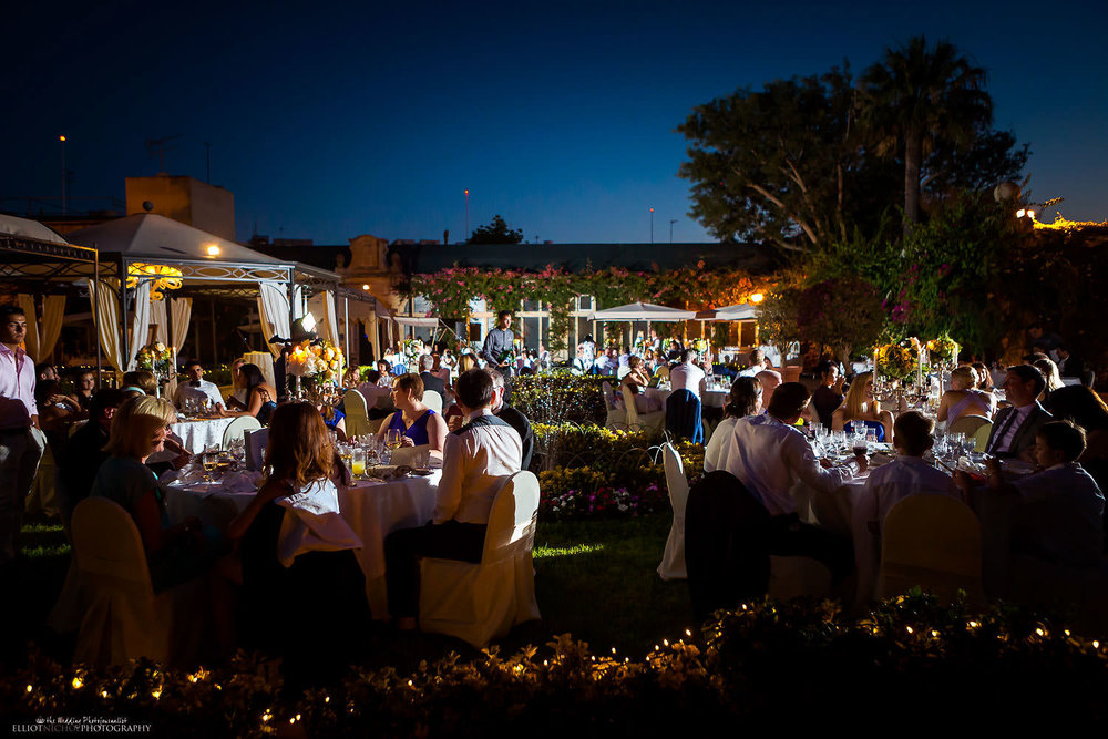 Evening garden wedding ceremony at the Palazzo Parisio in Naxxar in Malta.