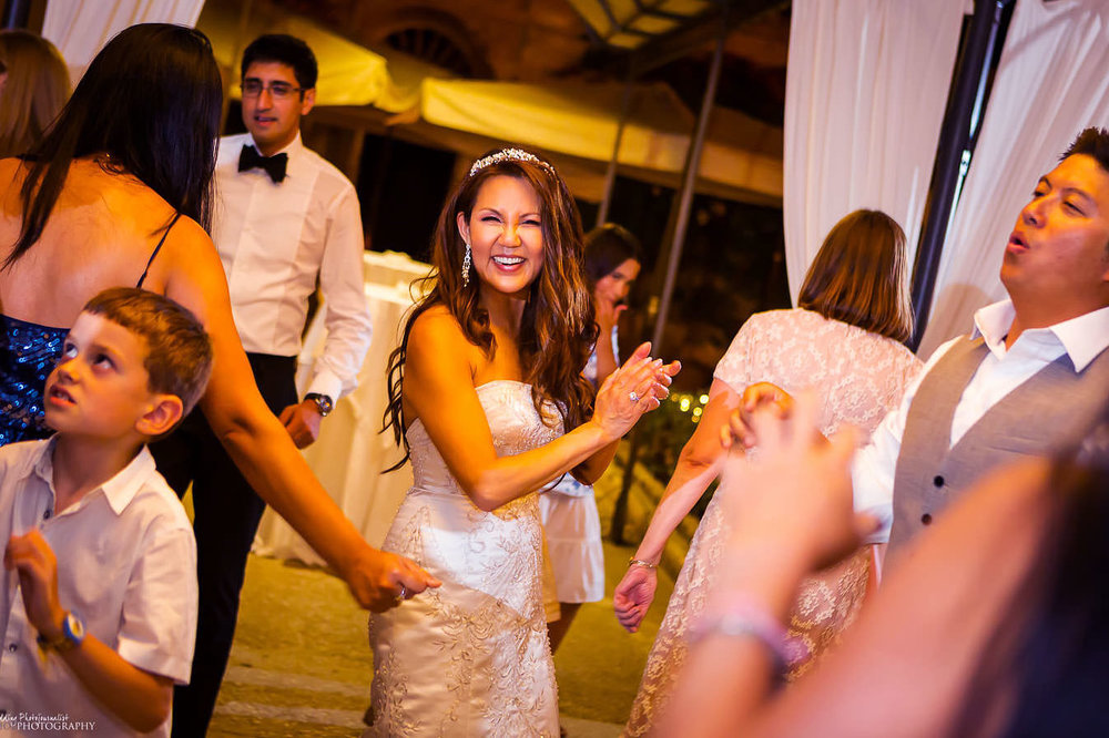 Bride dancing during her wedding reception at Palazzo Parisio in Malta.